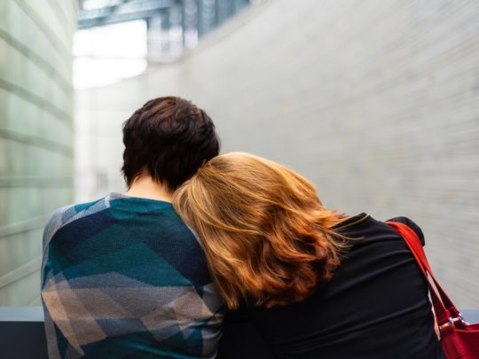 Two people comforting each other, representing the will executor services available from Funeralocity